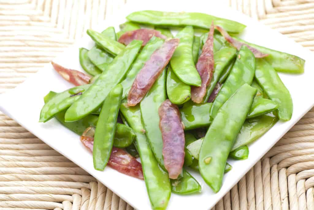 Snow peas sauted with sausage