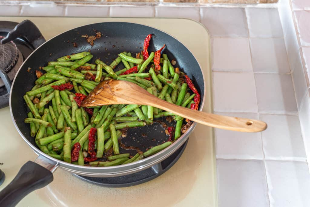 Snap beans sauted with dry chilis