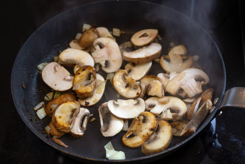 Steaming button mushrooms